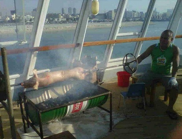 Cunard QE2 ship news - the roasted pig barbecue